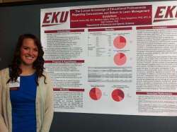 MIchelle Kuzma stands by her poster at the Celebrating Student Scholarship day