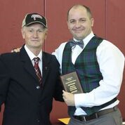 Joel Cormier received the Excellence in Service award from Chair Jack Rutherford