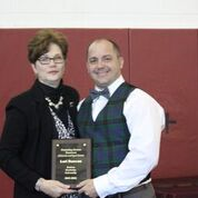 Lori Duncan receives Outstanding Alumna award from Joel Cormier