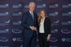 ESS Alumnus Kayla Bowman shown here with former President Clinton