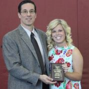 Katie Atkinson receives the Outstanding Senior Award from Dr. Jim Larkin